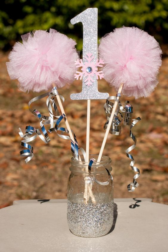 Pom poms centerpieces and snowflakes on pinterest