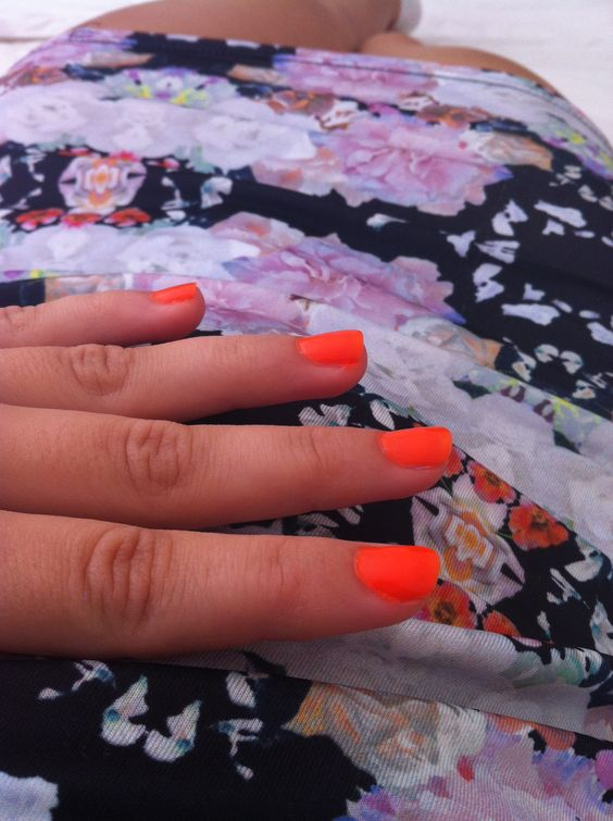 neon orange nail polish and floral print