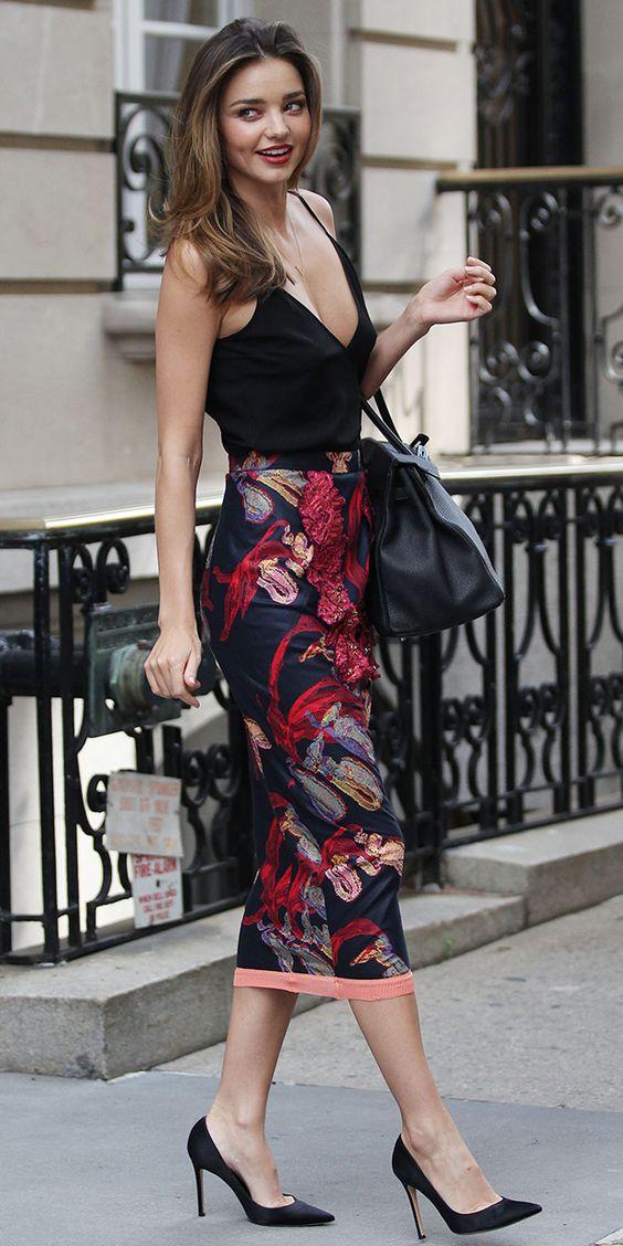 Miranda Kerr wears a black camisole, printed pencil skirt, and black pumps: