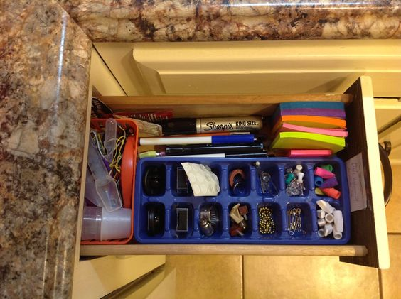 Inspired to get my narrow junk drawer organized, I used a ice cube tray and little basket from Dollar General. $1.30 total.: