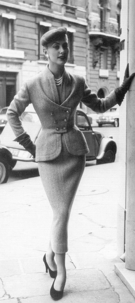 Geneviève in a Turkish blue tweed day suit by Pierre Balmain, photo by Willy Maywald, 1953