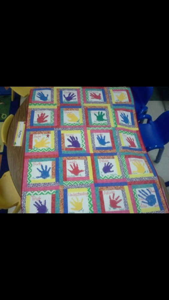 Custom quilt after buyer added handprints of daughters pre-k class
