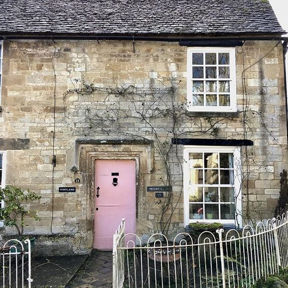 Classic Georgian Cotswold house Pink front door Burford