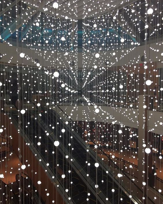Snarkitecture recently designed a lighting installation for Aventura Mall's holiday decor. Over 4000 LED bulbs hung from a massive structure above glow on and off resembling snow falling slowly onto the ground.