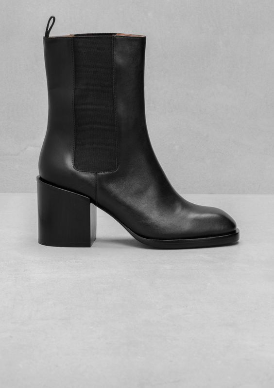 & Other Stories | Elastic Panel Boots. With a massive block heel, this statement boot features a high shafts with an elastic panel.