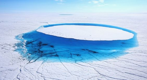 Water is seen on part of the glacial ice sheet that covers about 80 percent of Greenland. As the sea levels around the globe rise, researchers affiliated with the National Science Foundation and other organizations are studying the phenomena of the melting glaciers and their long-term ramifications.