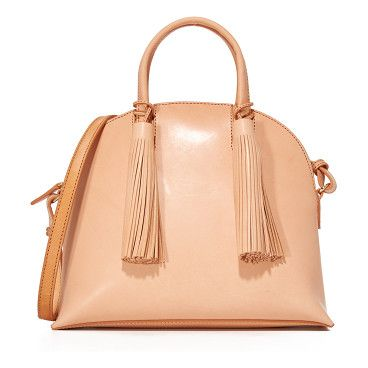 Dome satchel by Loeffler Randall. A smooth leather Loeffler Randall satchel with a rounded top. 2 tassels accent the front. Patch back pocket. Top zip ...