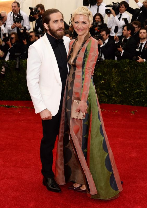 Jake Gyllenhaal hit the red carpet with his sister Maggie at the Met Gala on May 5, 2014. Maggie wore a Valentino dress and Fred Leighton rings for the star-studded event.