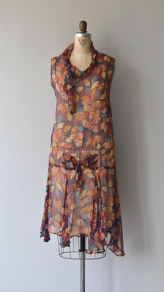 Feuilles d'Automne dress / Vintage 1920s silk chiffon dress with autumnal floral print, scarf collar and drop waist with bow detail.