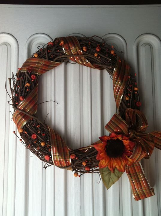 Homemade fall wreath. I used an 18 inch grapevine wreath, ribbon and some pumpkin garland. There you have it!