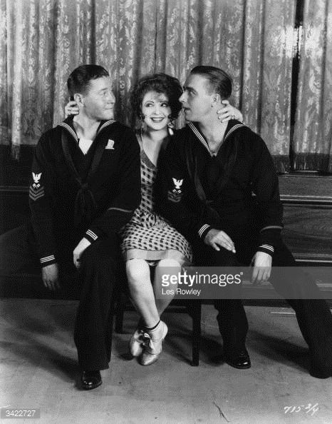 1928: James Hall, Clara Bow and Jack Oakie star in Paramount's 'The Fleet's In' directed by Malcolm St Clair. (Photo by Les Rowley/Hulton Archive/Getty Images