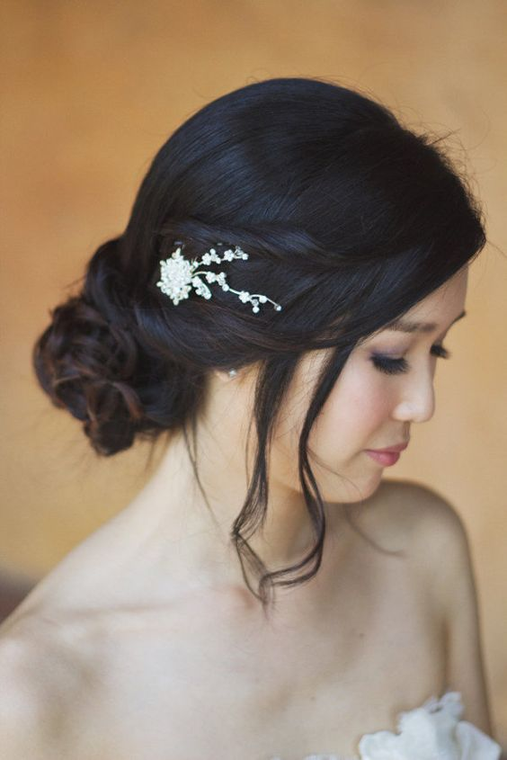 Twirls, pulled back with a delicate clip. wedding updo, wedding hairstyle, wedding hair clip, #indianwedding #indian #bride