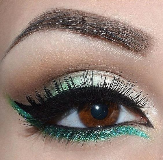 Pop of green on lower lash line.