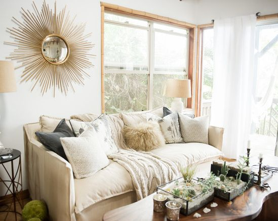 Step into an Artist's Airy Retreat // Gold mirror and various textured pillows