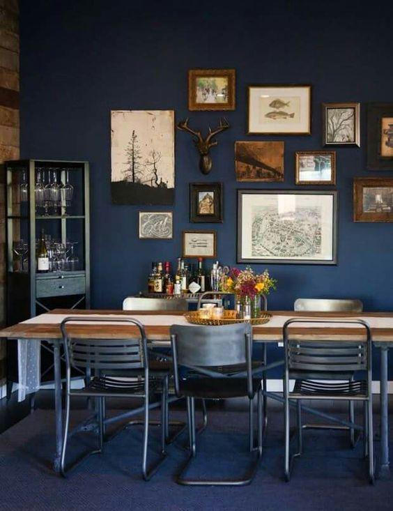 Casa Vogue - sala de jantar escura e industrial: