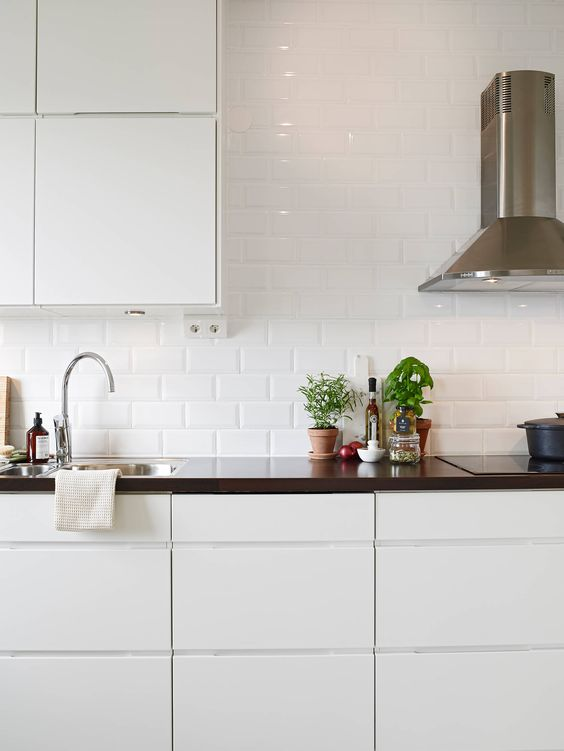 glossy white subway tile backsplash: