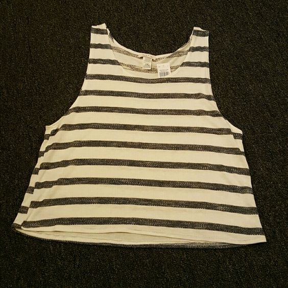 Loose Fitting Tank White & black tank has wide opening for arms could wear a bralette or bandeau underneath. love  J Tops Tank Tops