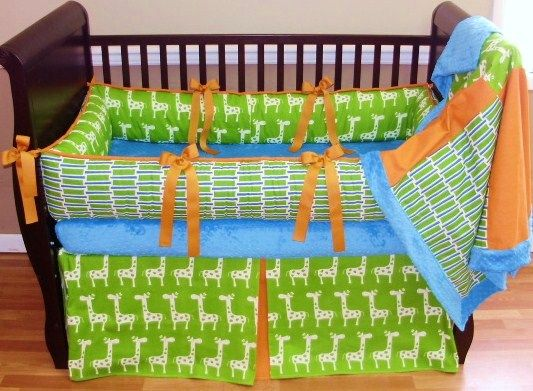 Lincoln Baby Bedding  This custom bedding set includes the bumper, blanket and tailored crib skirt. The green apple giraffe bumper features orange accents. The blanket is turquoise minky backed with a soft cuddle edge and the front coordinates all the fabrics.