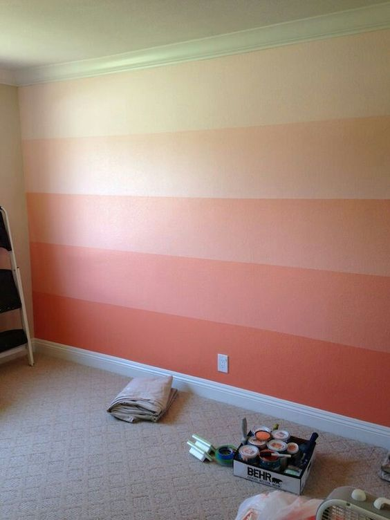Highlight the wall with the tint, tone and shades of coral colour: