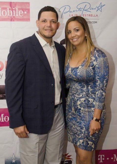 Yadier Molina y Wanda Molina.  Beautiful couple!  And the best catcher in baseball!!!