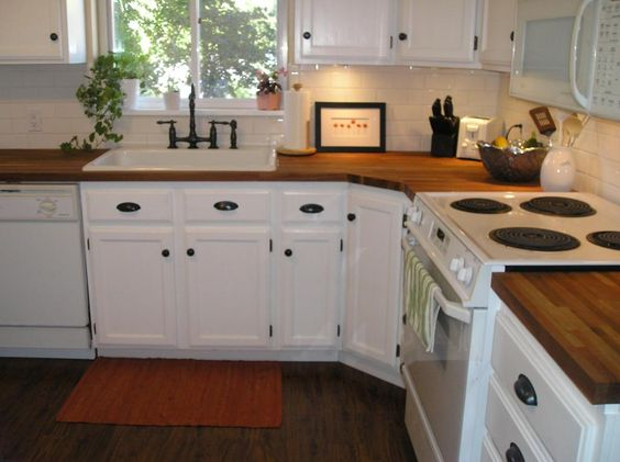 Butcher block counter tops with white cabinets kitchen for Countertop liquidators