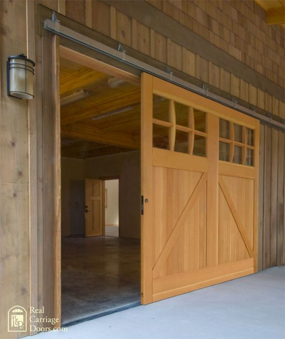 Single sliding barn door for a garage door the barn for Single sliding barn door