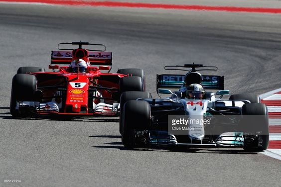 Lewis Hamilton of Great Britain driving the (44) Mercedes AMG Petronas F1 Team Mercedes F1 WO8 leads Sebastian Vettel of Germany driving the (5) Scuderia Ferrari SF70H on track during the United States Formula One Grand Prix at Circuit of The Americas on October 22, 2017 in Austin, Texas.