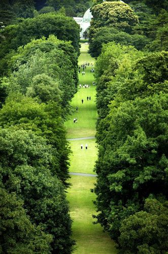 Kew Gardens: 2003: Members of the public wander through the Royal Botanical Gardens, UK