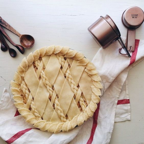 This is a pre-bake apple pie with a partial braid lattice and leaf…: