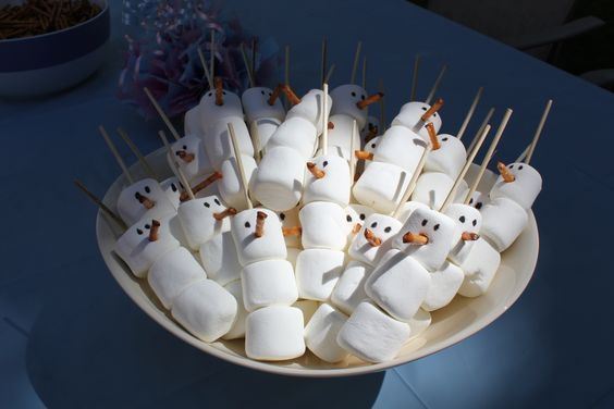 Olaf Snowman Marshmallow Treats - made with mini kabob sticks, marshmallows, pretzel stick (noses) and food dye pen for a Frozen Party.