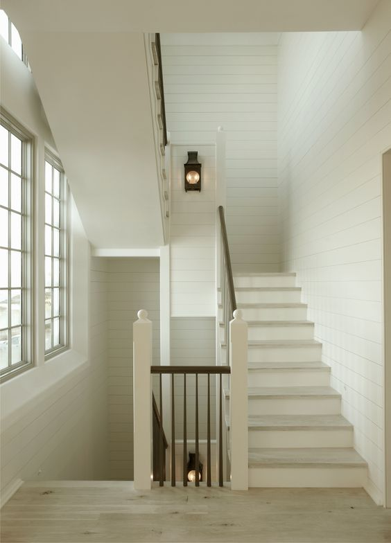Classic farmhouse country style with shiplap white walls and elegant #staircase - found on Hello Lovely Studio