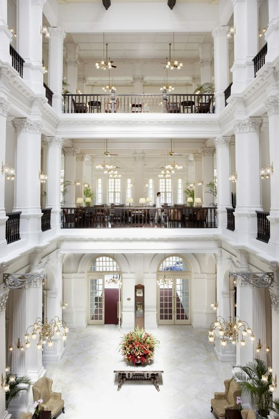 The iconic Raffles Hotel in Singapore where you can enjoy a Singapore Sling in the hotel's famous Long Bar