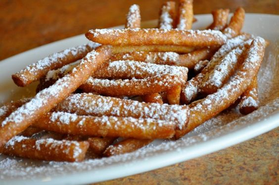 I grew up in Pennsylvania, and some believe the Pennsylvania Dutch to be the founders of Funnel Cake. So with that being said, I know my funnel cake! A few years back, I thought I was genius deciding to take the messiness out of the classic funnel cake and piping them out into finger-friendly fries. Turns out, it would soon turn into a trend. So here we have them, Funnel Cake Fries!