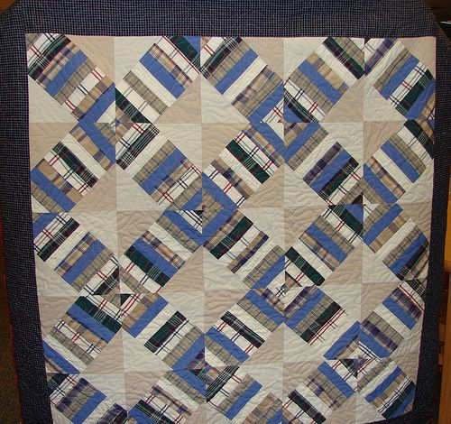 Memory quilt from shirts and pants. You can view this memory quilt and many others on my website ...