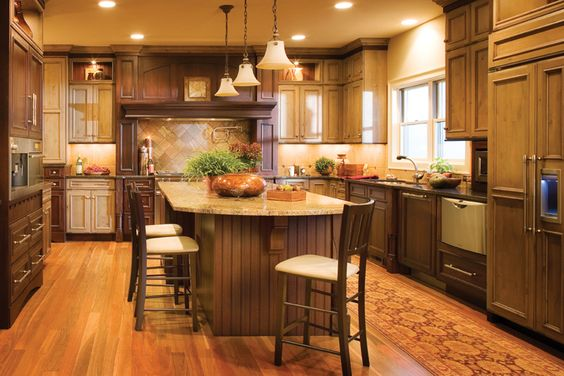 An island adds significant counterspace and food prep - Kitchen island with cooktop and prep sink ...