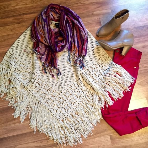 Tan/Cream knit fringe poncho Tan Cream knit fringe oversize poncho. Perfect condition. Never worn. No pulls. Perfect for layering. One size. OPEN TO OFFERS. DISCOUNTS ON BUNDLES! Sweaters