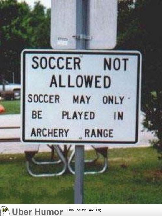 Apparently the people who posted this sign REALLY don't like soccer players. They want them to become archery targets, it seems!