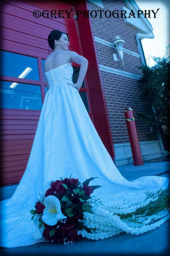 wedding, bride, bridal, dress, flowers, bouquet, red fire door. By Grey Photography