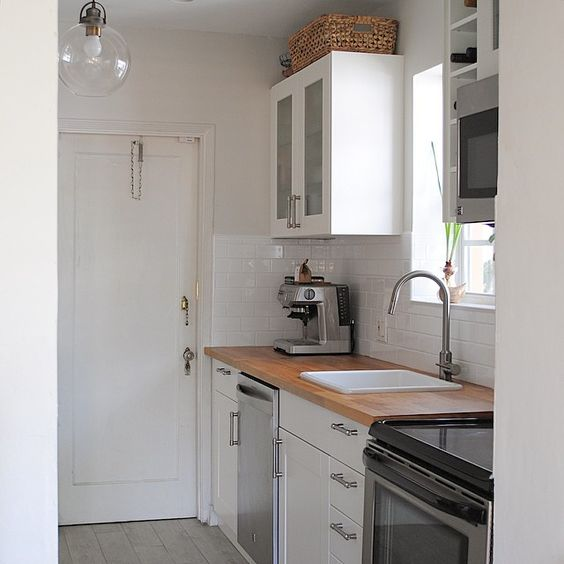 White on white kitchen. Cabinets are from @ikea, top baskets from @homegoods, lamp from @jossandmain.