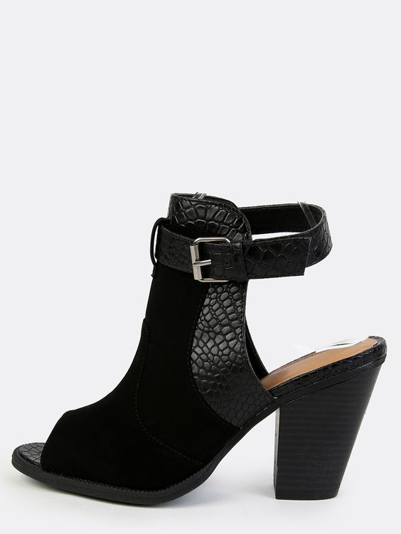 """Show off your wild side with the Faux Reptile Skin Booties! Features a peep toe, faux reptile skin trim, adjustable ankle strap, backless cut, and a nubuck upper. Finished with a slightly padded insole and a  3"""" stacked heel. Pair with slim ankle grazer jeans!"""