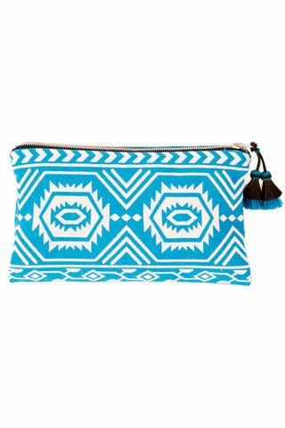 Turquoise Vision Quest Clutch by Wax + Cruz. This graphic beauty holds all your treasures and easily takes you from day to night.  The fabric was woven in India and it has a horsehair tassel pull.