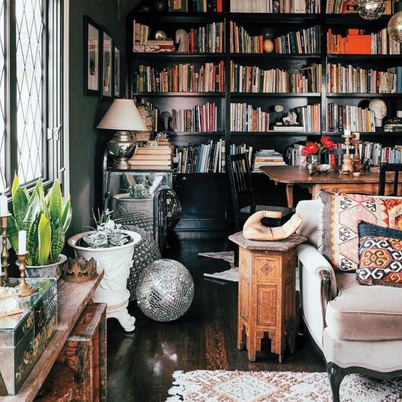 Books on books on #books! Amplify your #eclectic look with floor-to-ceiling bookcases, and arrange books vertically with an eye-catching object here and there. Also, a disco ball never hurts. : Thomas J. Story #LinkInProfile