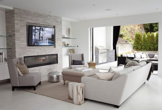 Amazing Family Room With Stacked Glass Floating Shelves Over Floating White Lacquer Cabinets