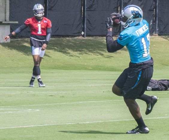 Carolina Panther Devin Funchass (17) makes a turn after catching a pass from quarterback Cam Newton (1).The Carolina Panthers held practice 09.10.15 midday at their practice field near Bank of America Stadium.