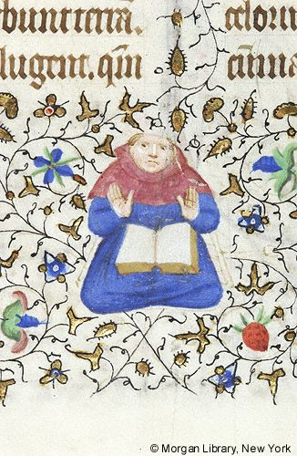 Monk, tonsured, orant, seated with open book on lap, in lower margin. Text from Mass for Virgin Mary,  Book of Hours, Paris, 1420-25. MS M.1004 fol. 170r.