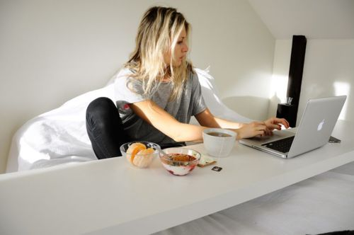 witanddelight:  i need to have one of these bed desks built! thanks todreammessy, the desk is from IKEA, its theMalm Occasional Table!  this - this is what I need. no need to get out of bed.