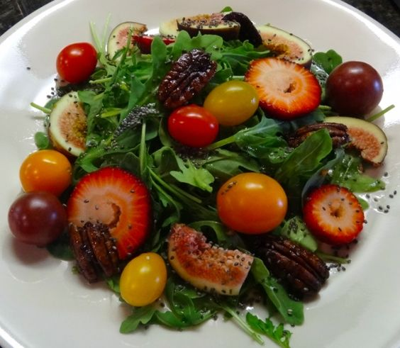 Salad for dinner tonight: Arugula salad w/ homemade apple cider-honey vinaigrette dressing, figs, strawberries, cherry tomatoes, chia seeds and caramelized pecans
