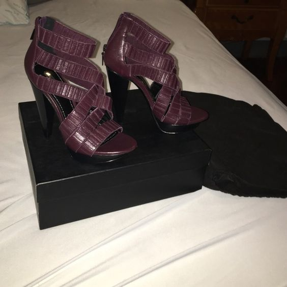 Women's Platform Heel by Report. Purple. Size 7. These shoes have never been worn. Comes with dust bag and box. They're purple high heels. Extremely high but cute shoes. Report Signature Shoes Heels