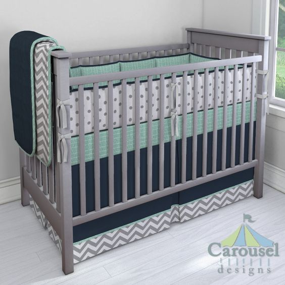 Crib bedding in Mint Herringbone, Solid Navy, White and Gray Zig Zag, Solid Navy Minky, White and Gray Polka Dot, Silver Gray Minky. Created using the Nursery Designer® by Carousel Designs where you mix and match from hundreds of fabrics to create your own unique baby bedding. #carouseldesigns