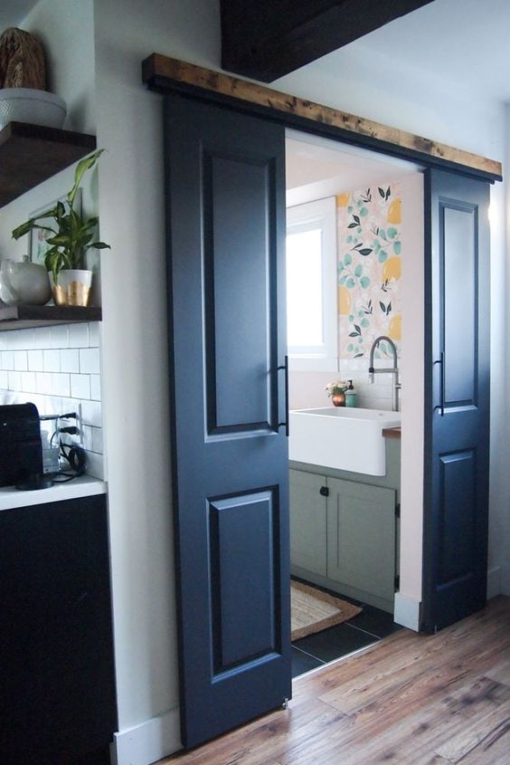 DIY Double barn doors - like the concept, the door handles & most of all the idea of the cover over the top rail